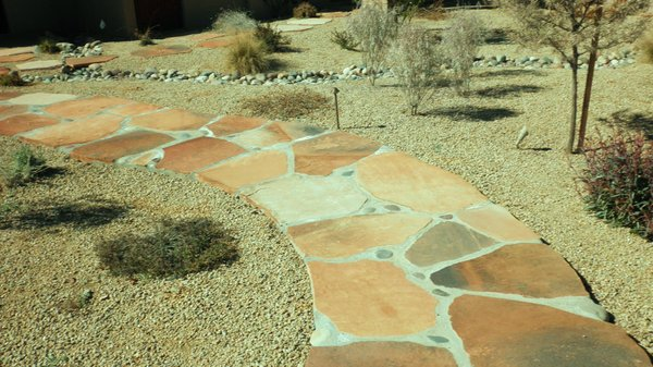 wet-layed-flagstone-pathway-with-large-grout-line-river-rock